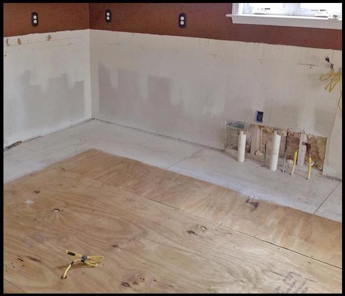 Subflooring in a kitchen after water damage restoration services