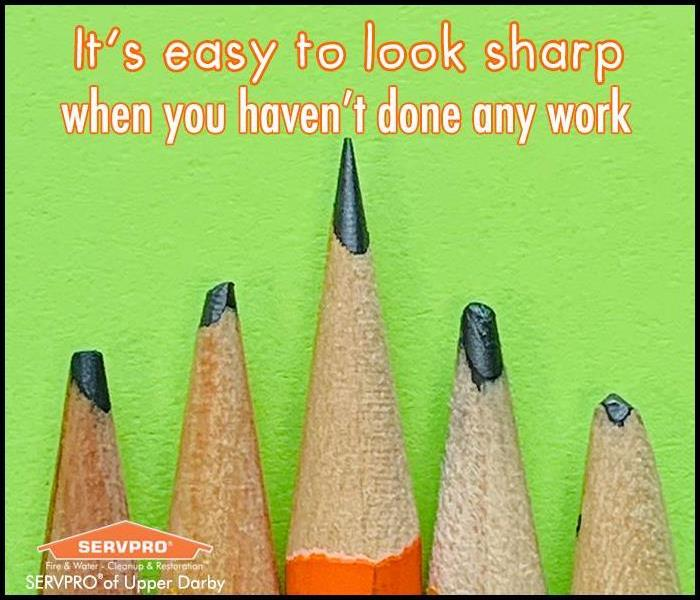 Image of 5 pencils, one sharp and 4 dull, with a green background