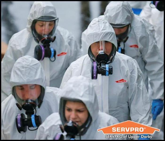 Servpro crew in PPE on a COVID-19 cleaning & disinfecting job
