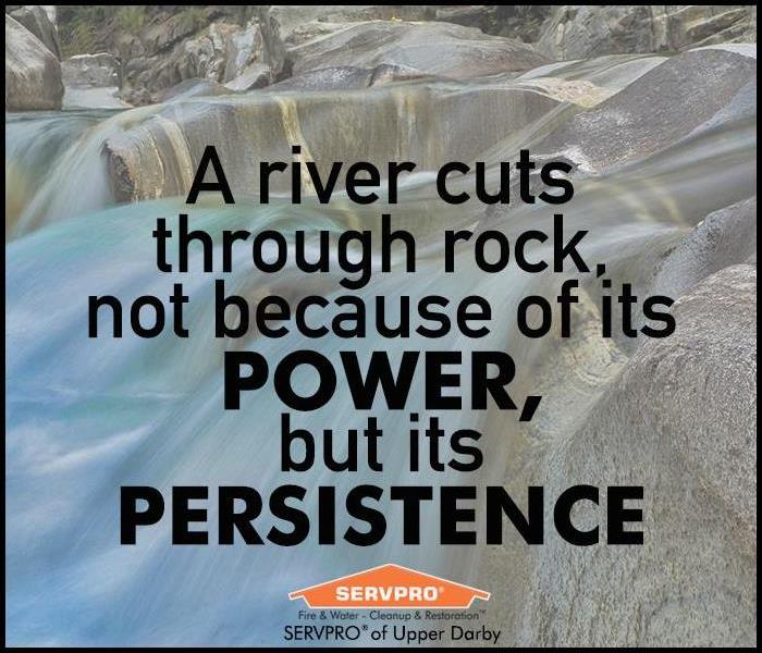 River running over rocks with text of a quote