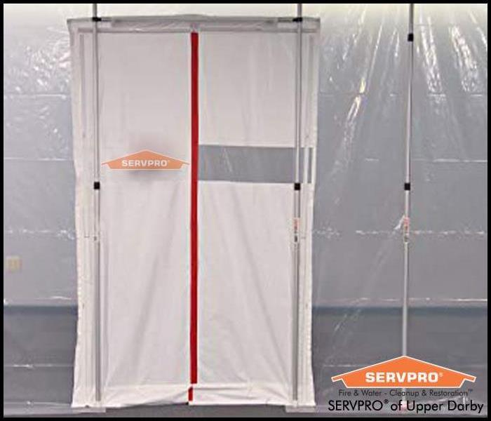 plastic containment set up with a SERVPRO logo