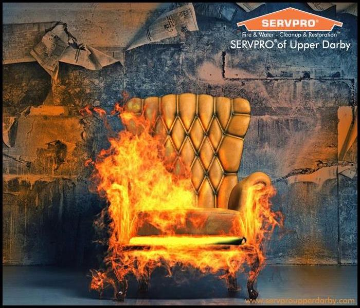Gold high back upholstered chair in flames